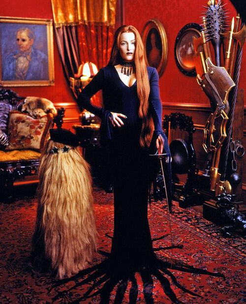 Gillian Anderson as Morticia Addams